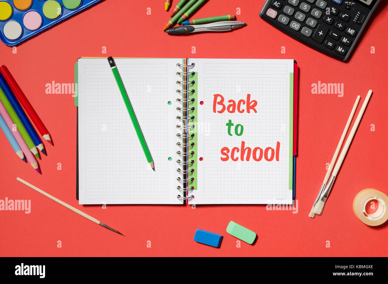 notepad with back to school words and office stationery red stock