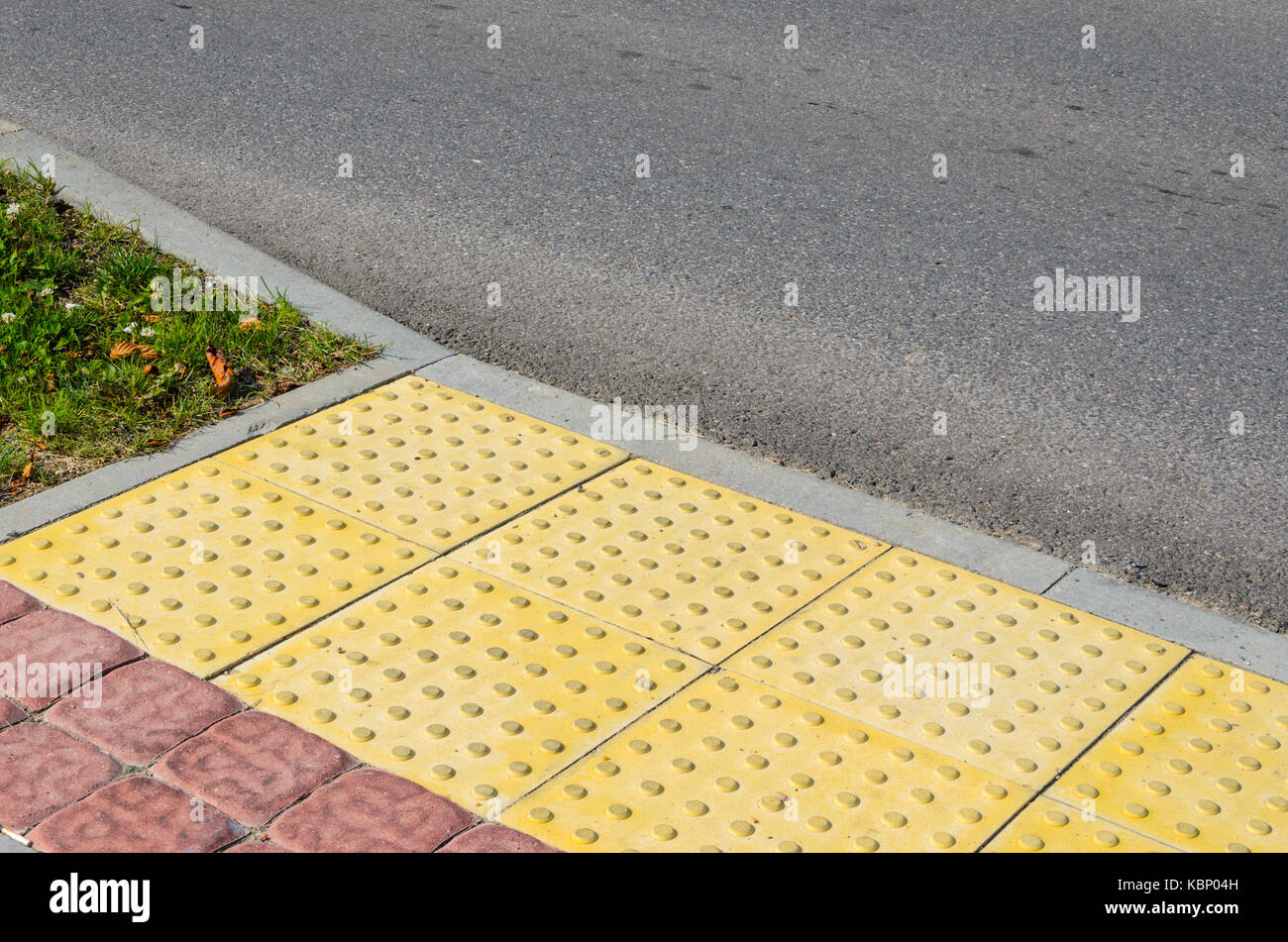 Tactile pavement stock photos tactile pavement stock images alamy adjoining pavement with a tactile tile for blind peoples and an asphalt road joint of dailygadgetfo Image collections