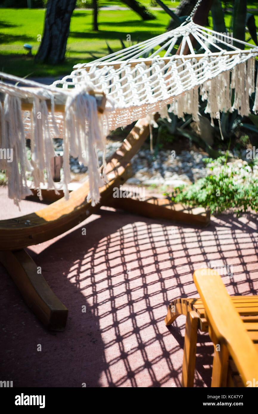 hammock on the tropical beach in the sunlight stock photo royalty