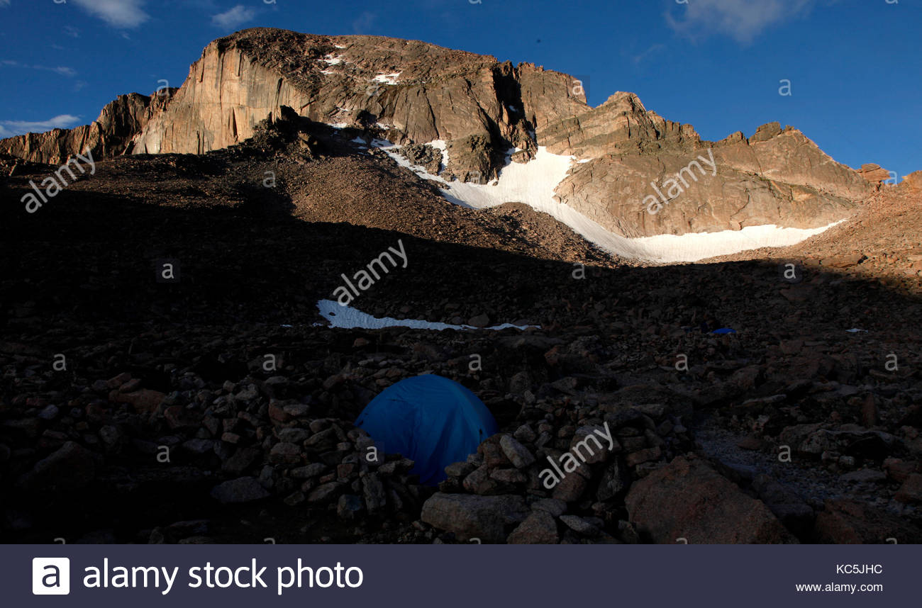 A tent sits in the shadows as the sun rises on Longs Peak in Rocky Mountain & Rocky Mountain Tent Stock Photos u0026 Rocky Mountain Tent Stock ...