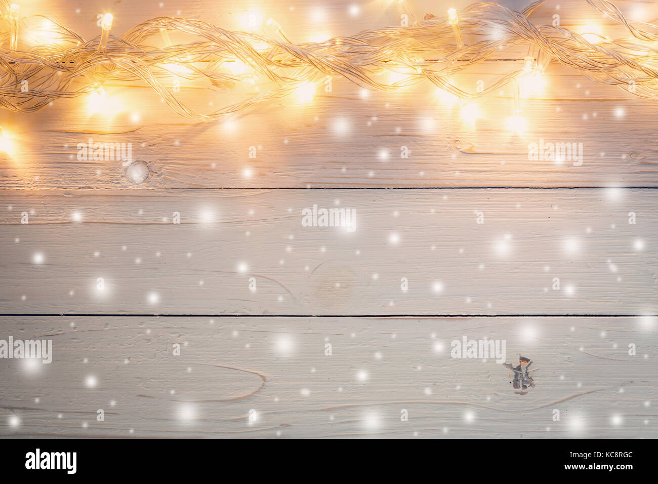 Christmas Light And Decoration With Snow On White Wood Background Copy Space