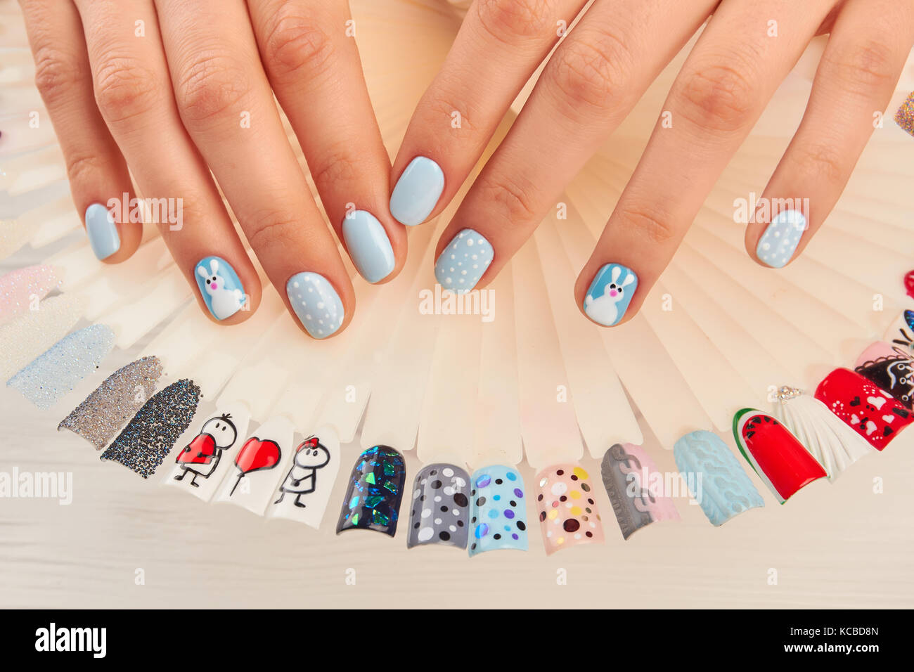 Manicured hands and nail art samples Stock Photo: 162521093 - Alamy