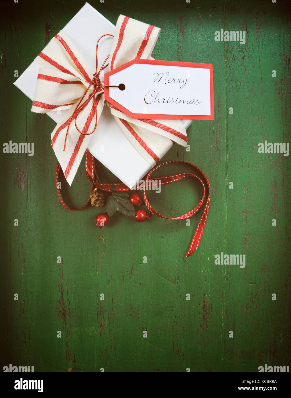 Christmas Holiday Background With Red White Gift Against A Vintage Style Dark Green Recycled Wood Vertical