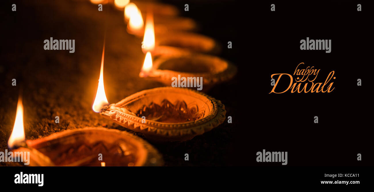 Happy diwali greeting card design using beautiful clay diya lamps happy diwali greeting card design using beautiful clay diya lamps lit on diwali night celebration indian hindu light festival called diwali a festi m4hsunfo