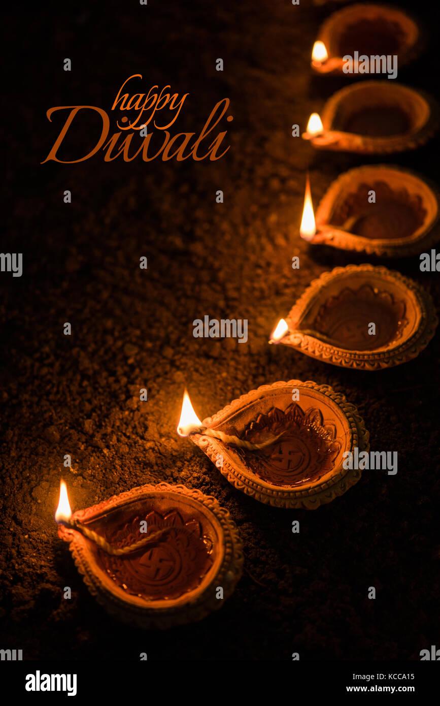 Happy diwali greeting card design using beautiful clay diya lamps happy diwali greeting card design using beautiful clay diya lamps lit on diwali night celebration indian hindu light festival called diwali a festi kristyandbryce Choice Image