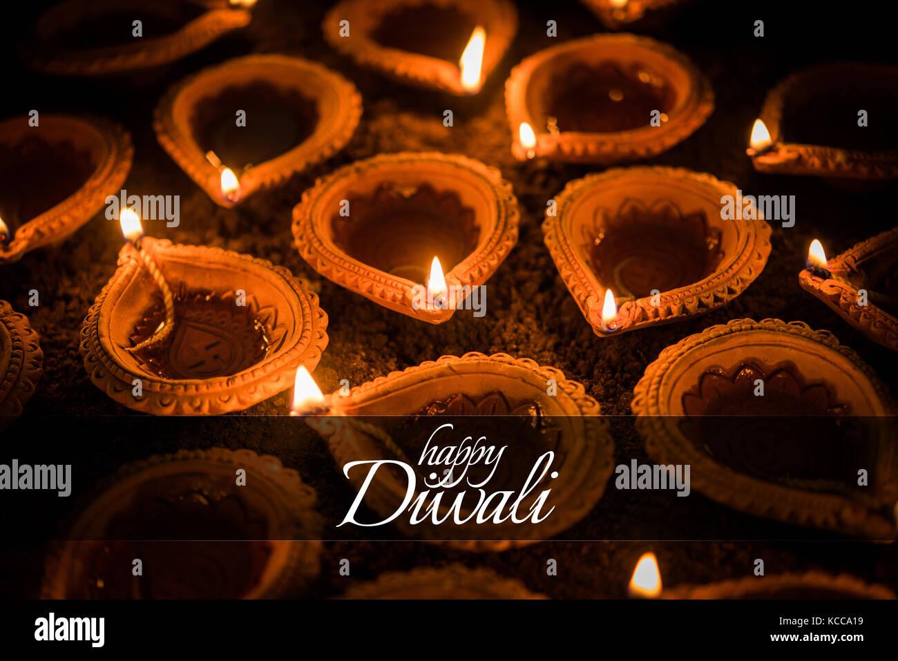 Happy diwali greeting card design using beautiful clay diya lamps happy diwali greeting card design using beautiful clay diya lamps lit on diwali night celebration indian hindu light festival called diwali a festi m4hsunfo