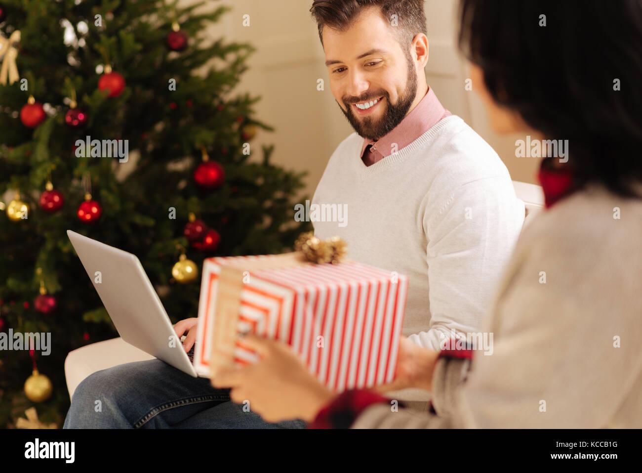 Loving wife giving her husband Christmas gift Stock Photo: 162541276 ...