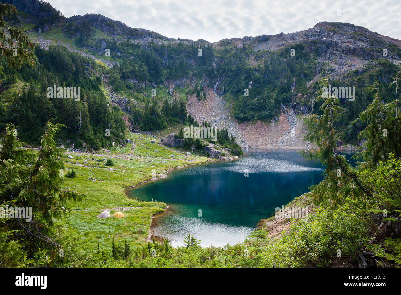 Tents beside Cobalt Lake along the trail to 5040 Peak in the Alberni-Clayoquot region & Tents By The Lake Stock Photos u0026 Tents By The Lake Stock Images ...