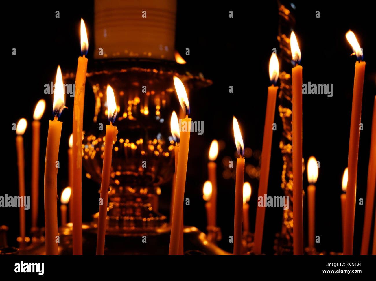 Burning Wax Candles In Christian Church As A Symbol Of Faith In