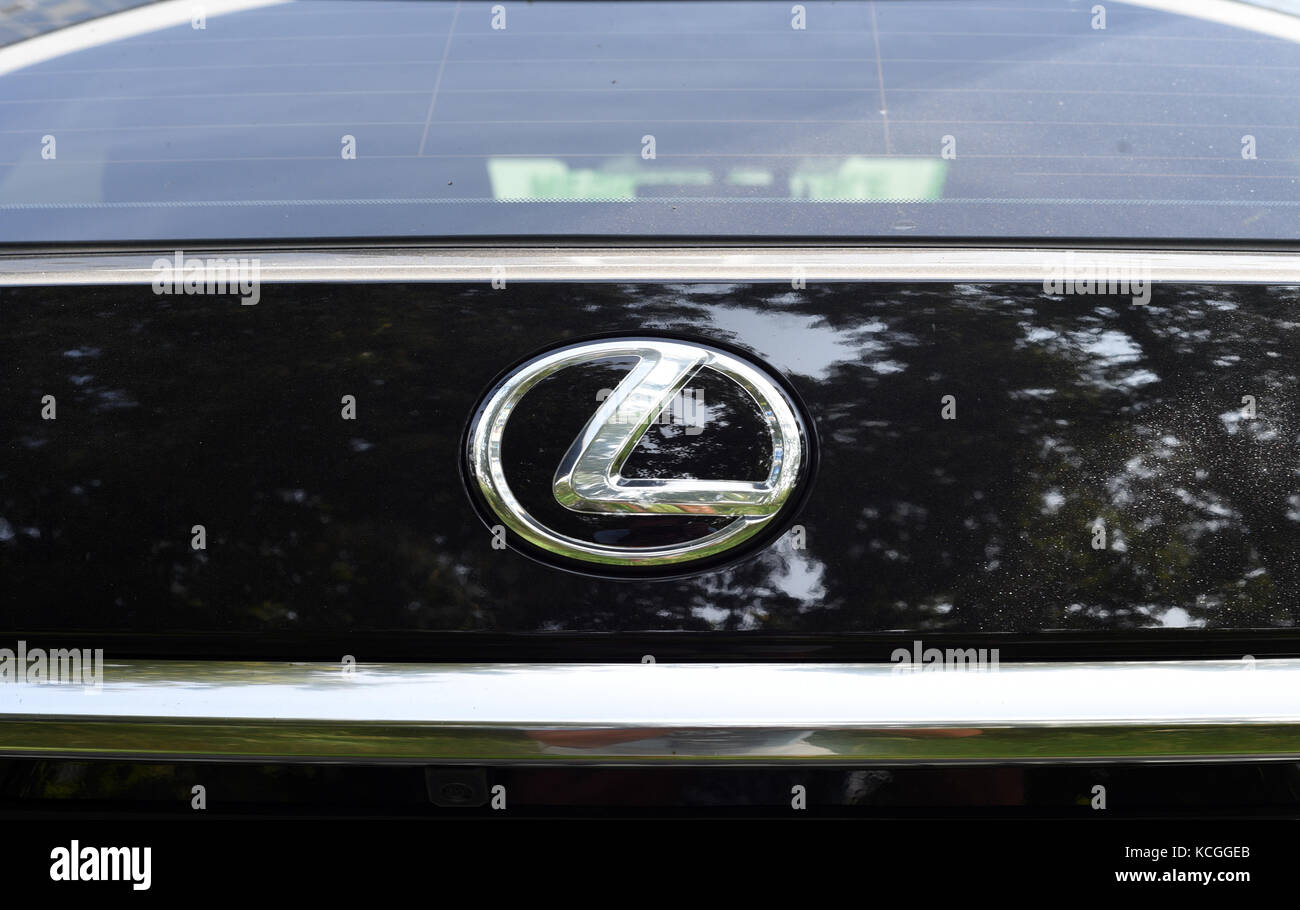 Lexus Car Symbol And Company Logo On The Front Of A Car Vehicle