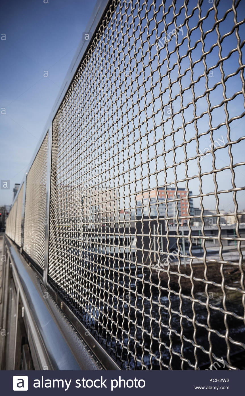 close up of a metal grid fence in the city stock photo 162644638