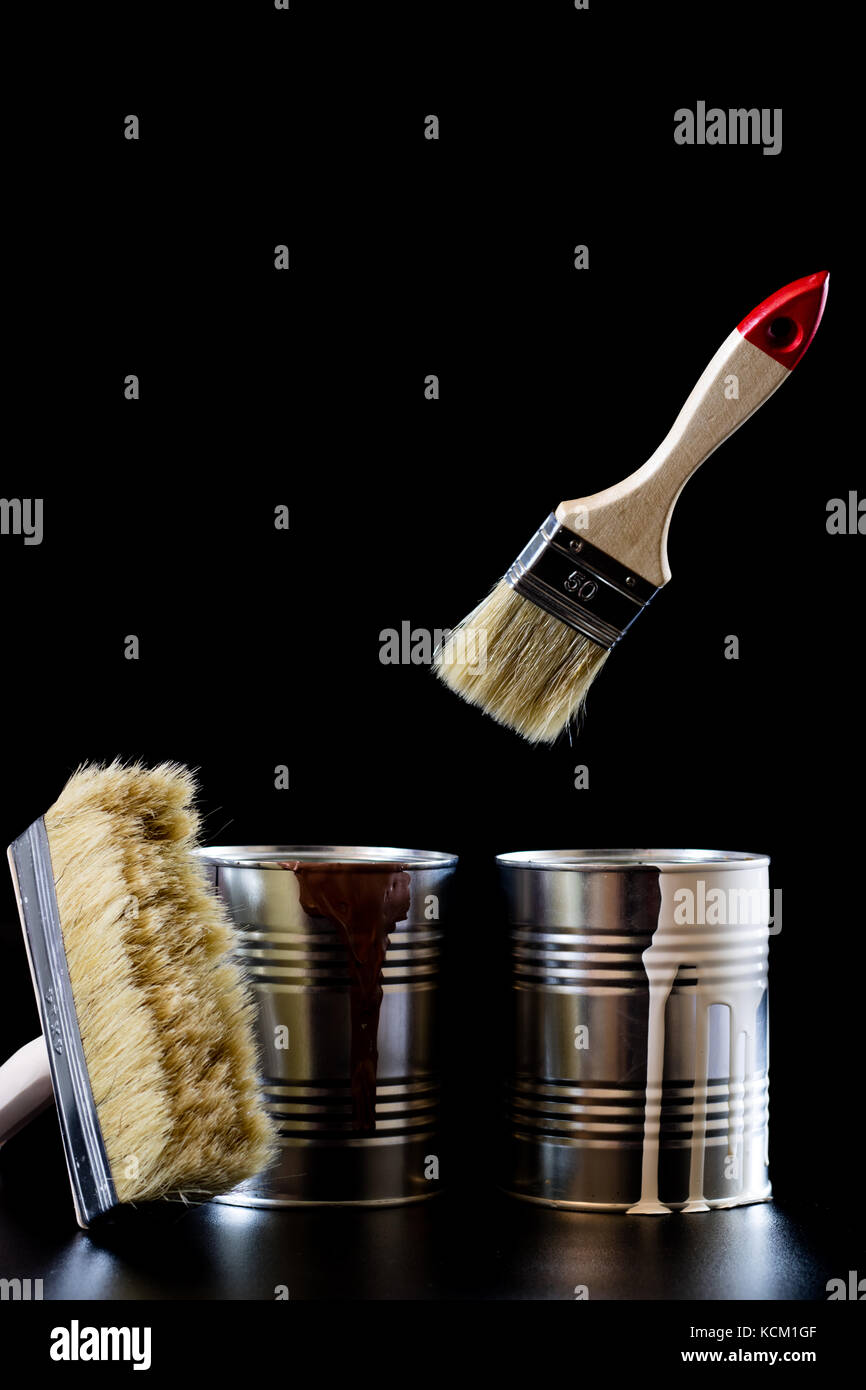 Canned Air Painting : Paintbrush dripping orange paint isolated stock photos