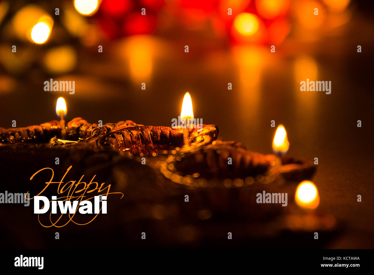 Diwali greetings stock photos diwali greetings stock images alamy stock photo of diwali greeting card showing illuminated diya or oil lamp or panti with happy kristyandbryce Image collections