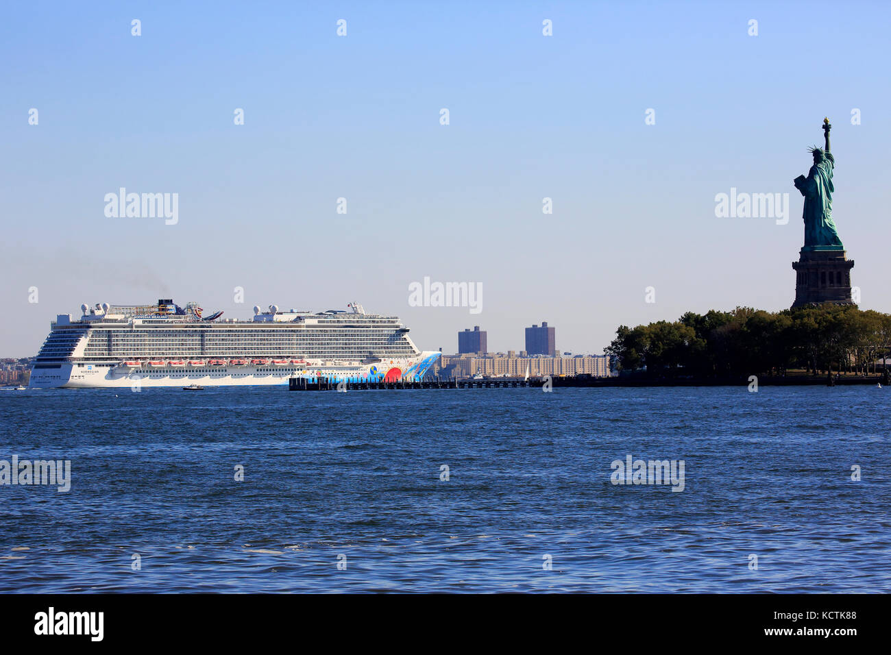 Norwegian Breakaway Cruise Ship Passing Liberty Island With Statue - Cruise ships from new jersey