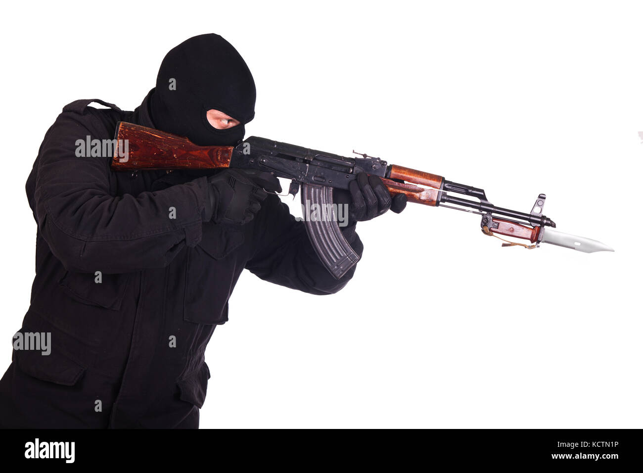 man in black uniform and mask with AK 47 gun Stock Photo