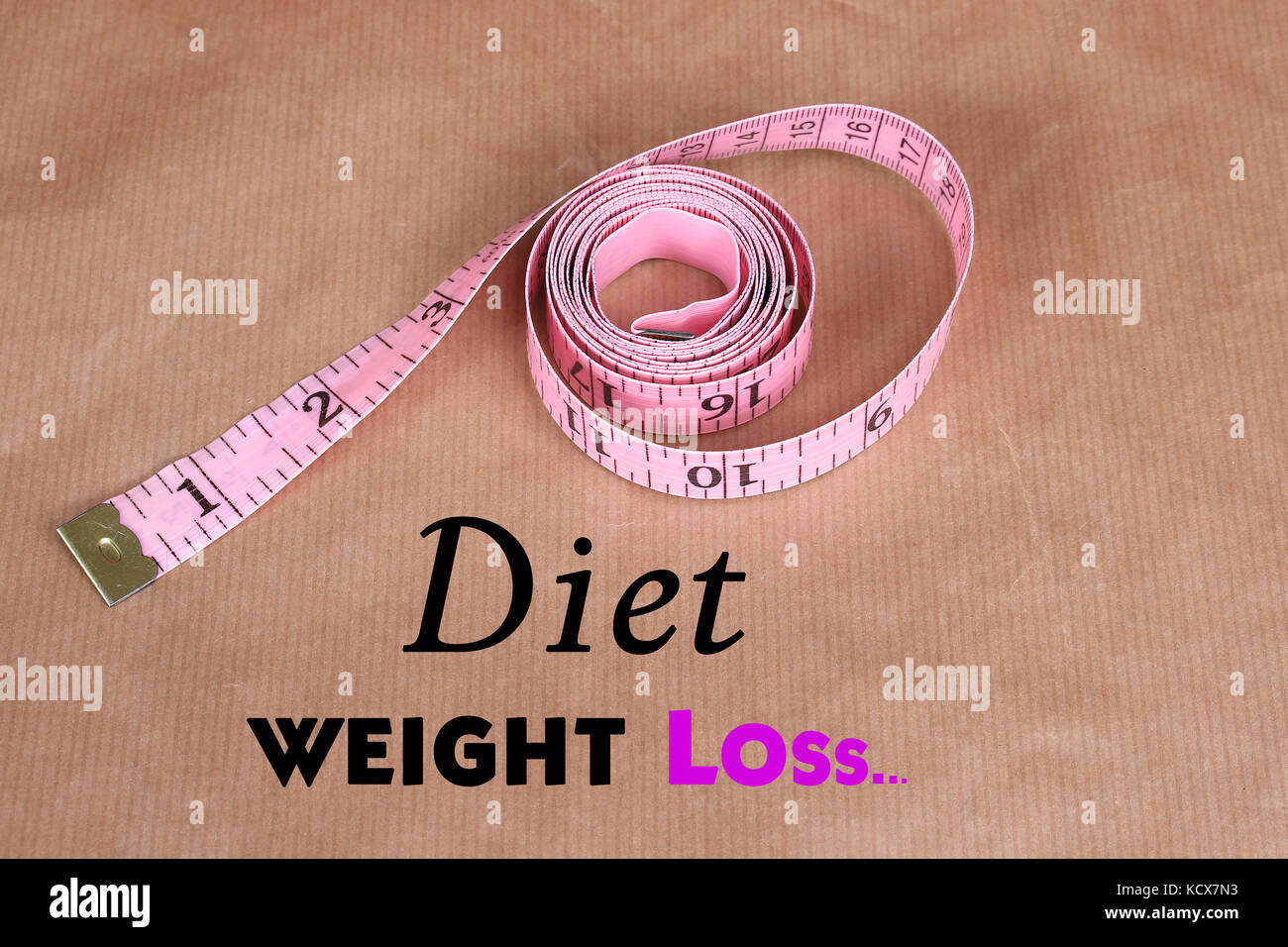 rolled pink measuring tape for monitoring weight loss progress stock