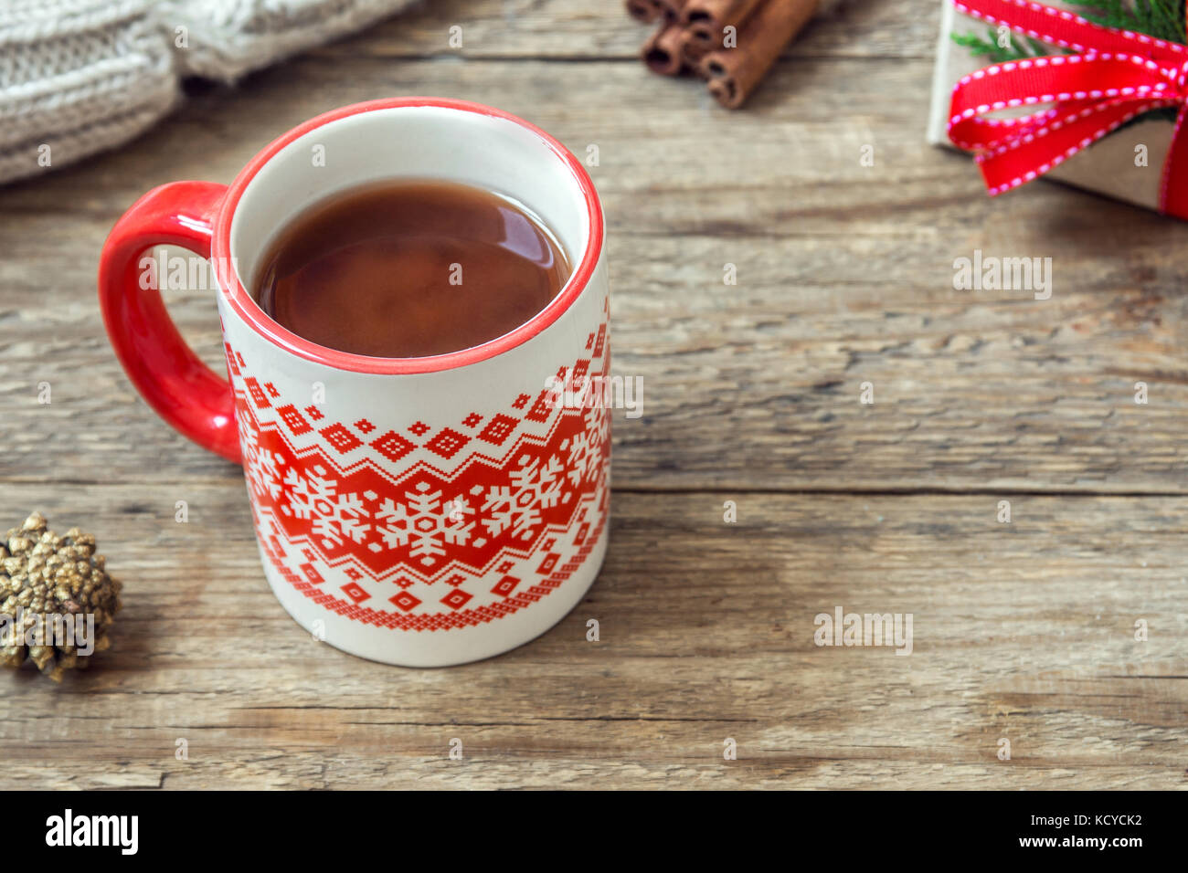 Christmas hot chocolate drink with Christmas gift and scarf on ...