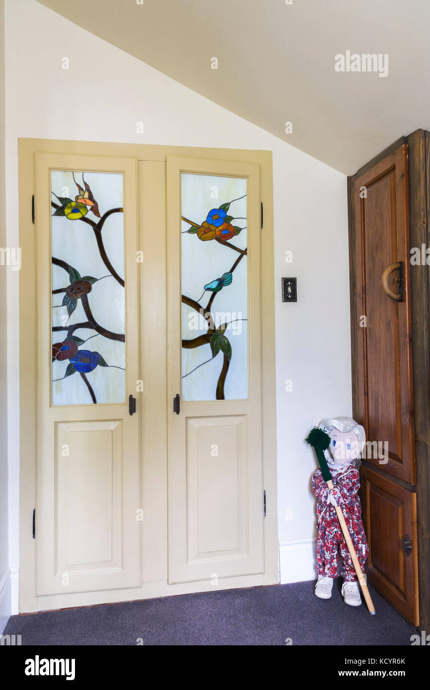 Entryway With Ragdoll And Wooden Built In Armoire And Closet Doors With  Satined Glass Panels Inside An Old Reconstructed 1886 Canadiana Cottage  Style ...