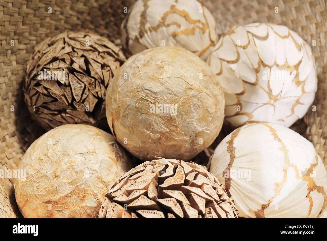 Home Decor Close Up Of Ornamental Decorative Balls In A Woven Stock