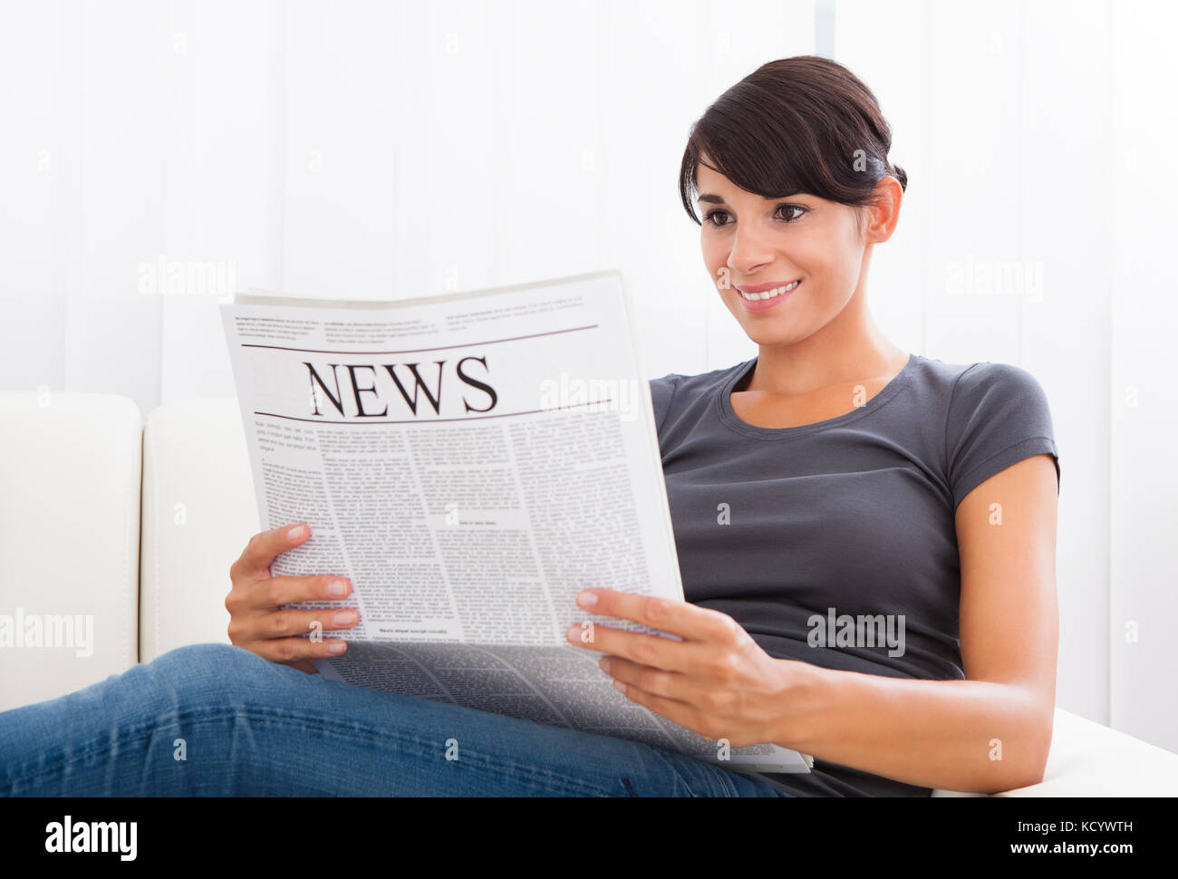 Young Female Reading Daily Newspaper Stock Photos & Young ...