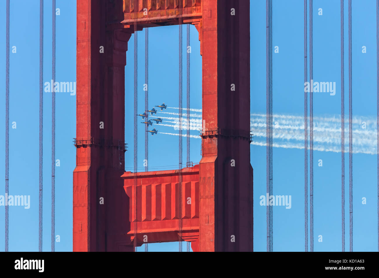 The United States Navy airplanes, The Blue Angles, fly over the Golden Gate Bridge during the airshow performance Stock Photo
