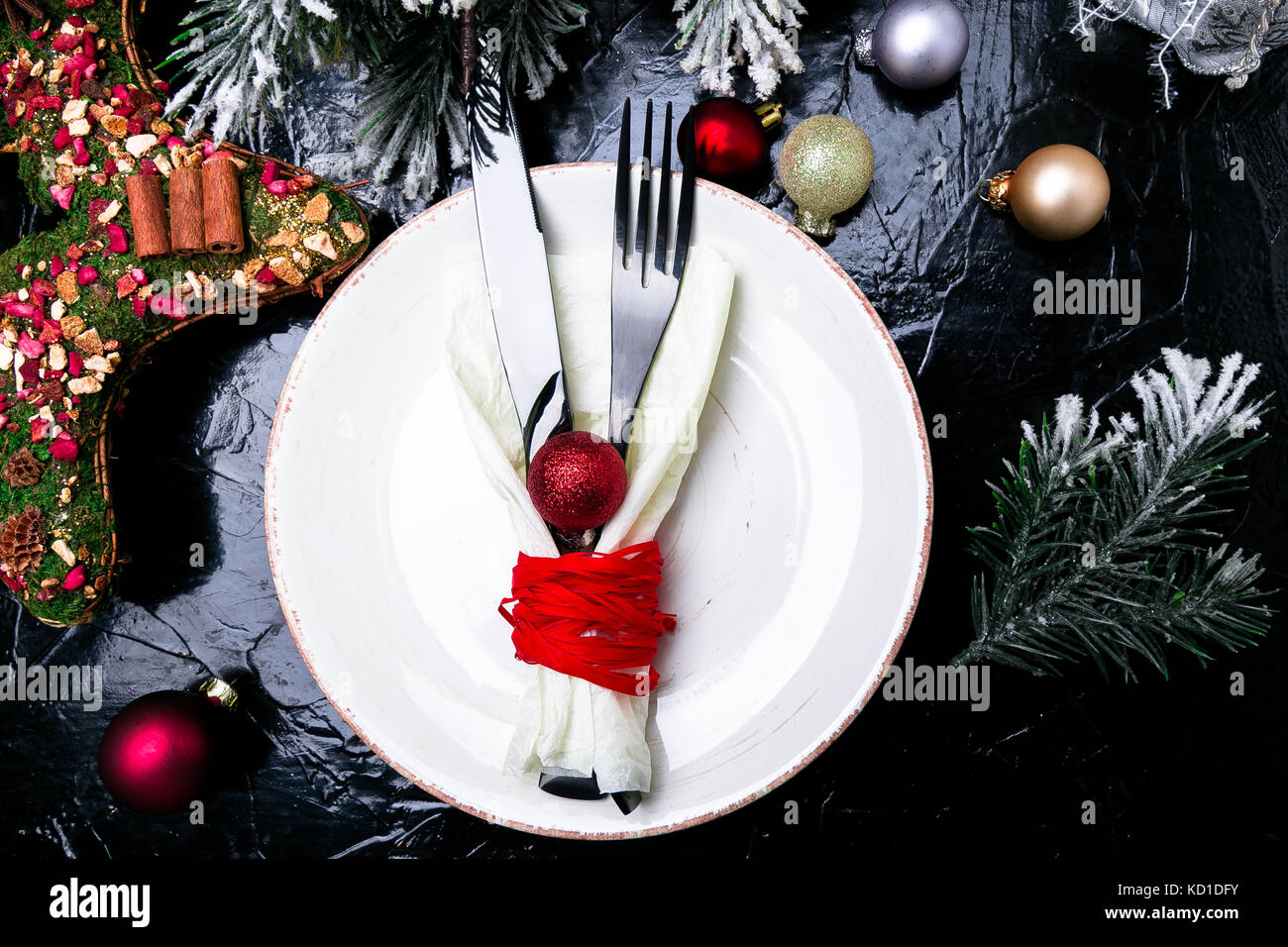 Christmas table place setting. Holidays background. White plate ...