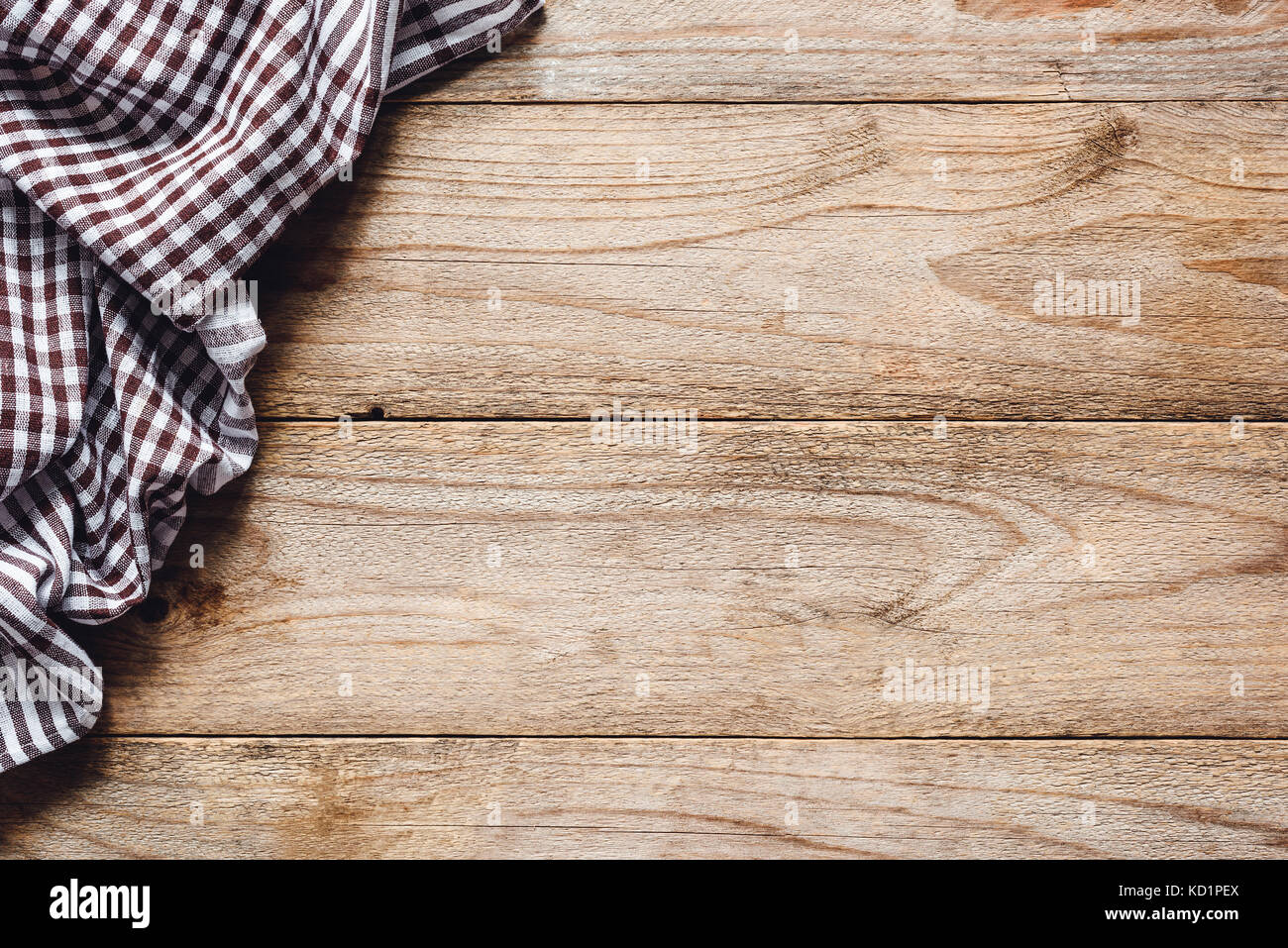 wooden table background with kitchen textile or kitchen napkin stock