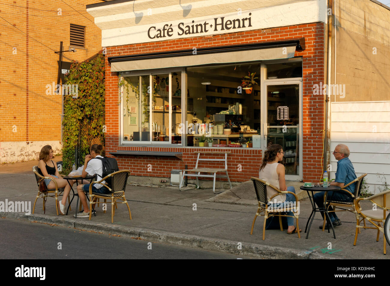 People Talking At Cafe Table Outside The Saint Henri Coffee Shop Across From Jean Talon Market Montreal Quebec Canada