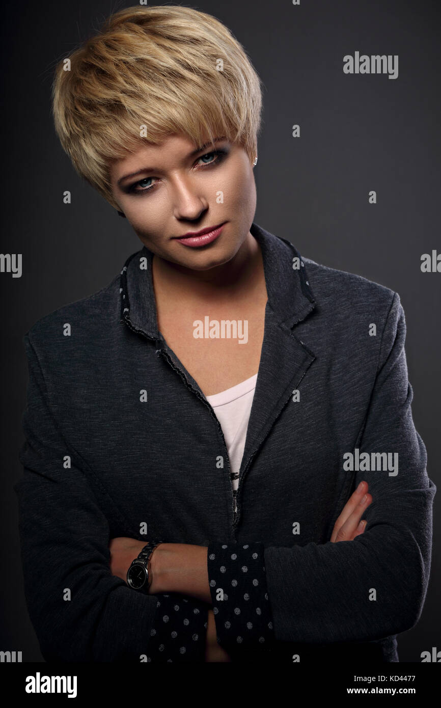 Beautiful Serious Business Woman With Short Bob Blond Hairstyle In