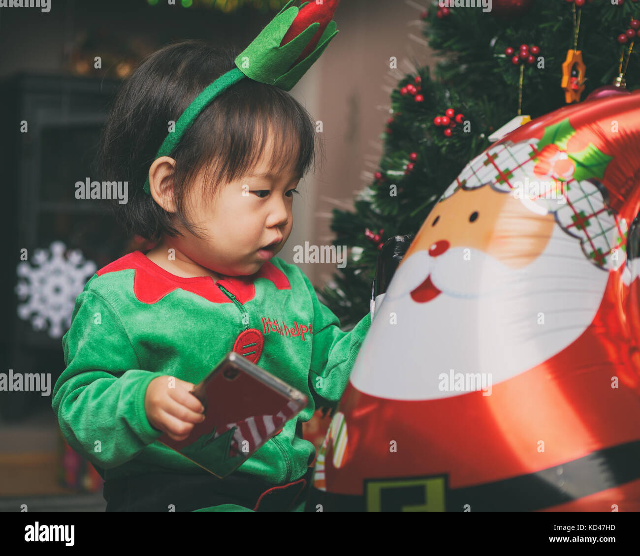 Christmas baby asian stock photos christmas baby asian for Baby christmas tree decoration