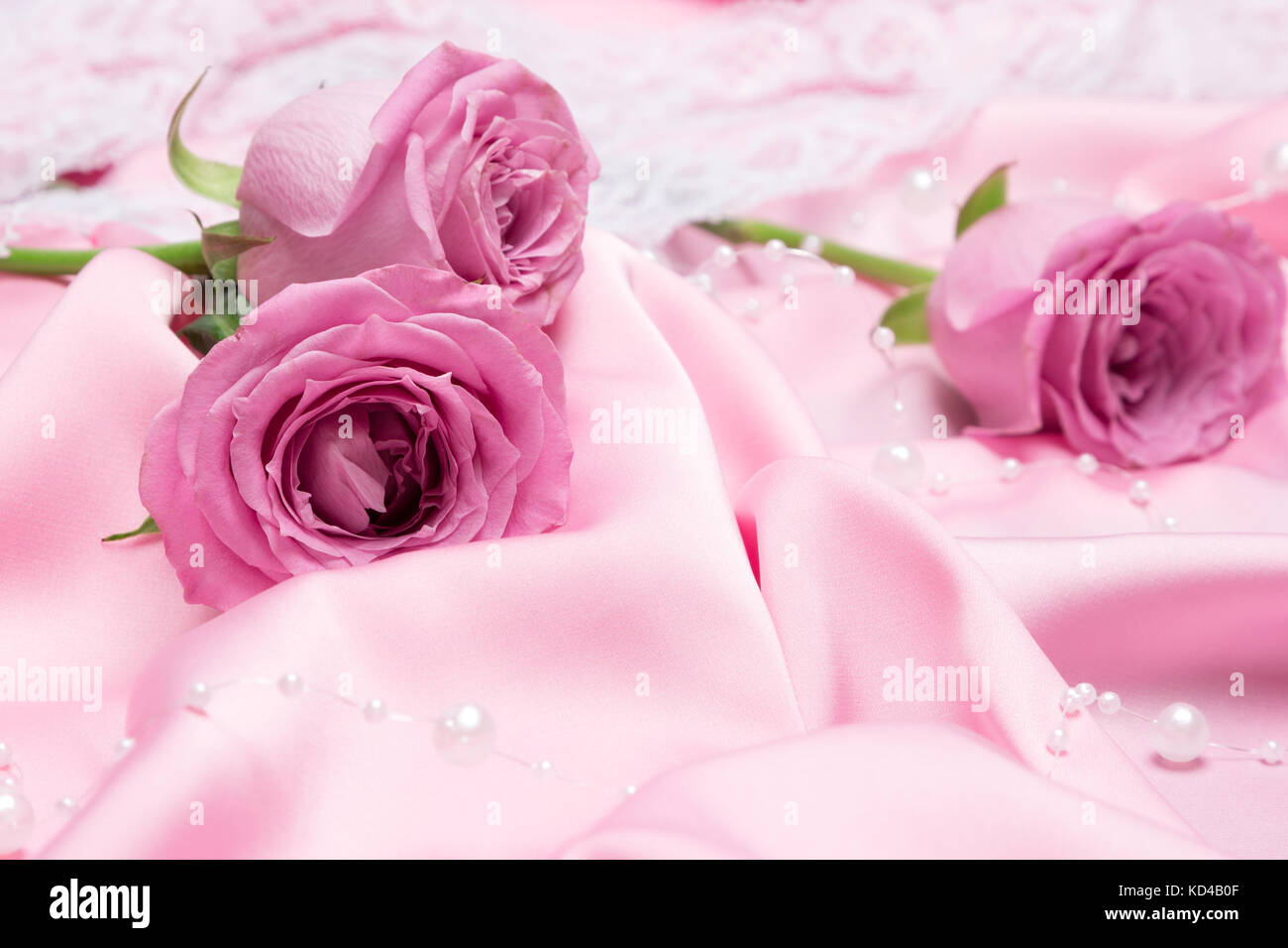Pink Roses On Folded Silk Fabric With White Bead Strand Romantic