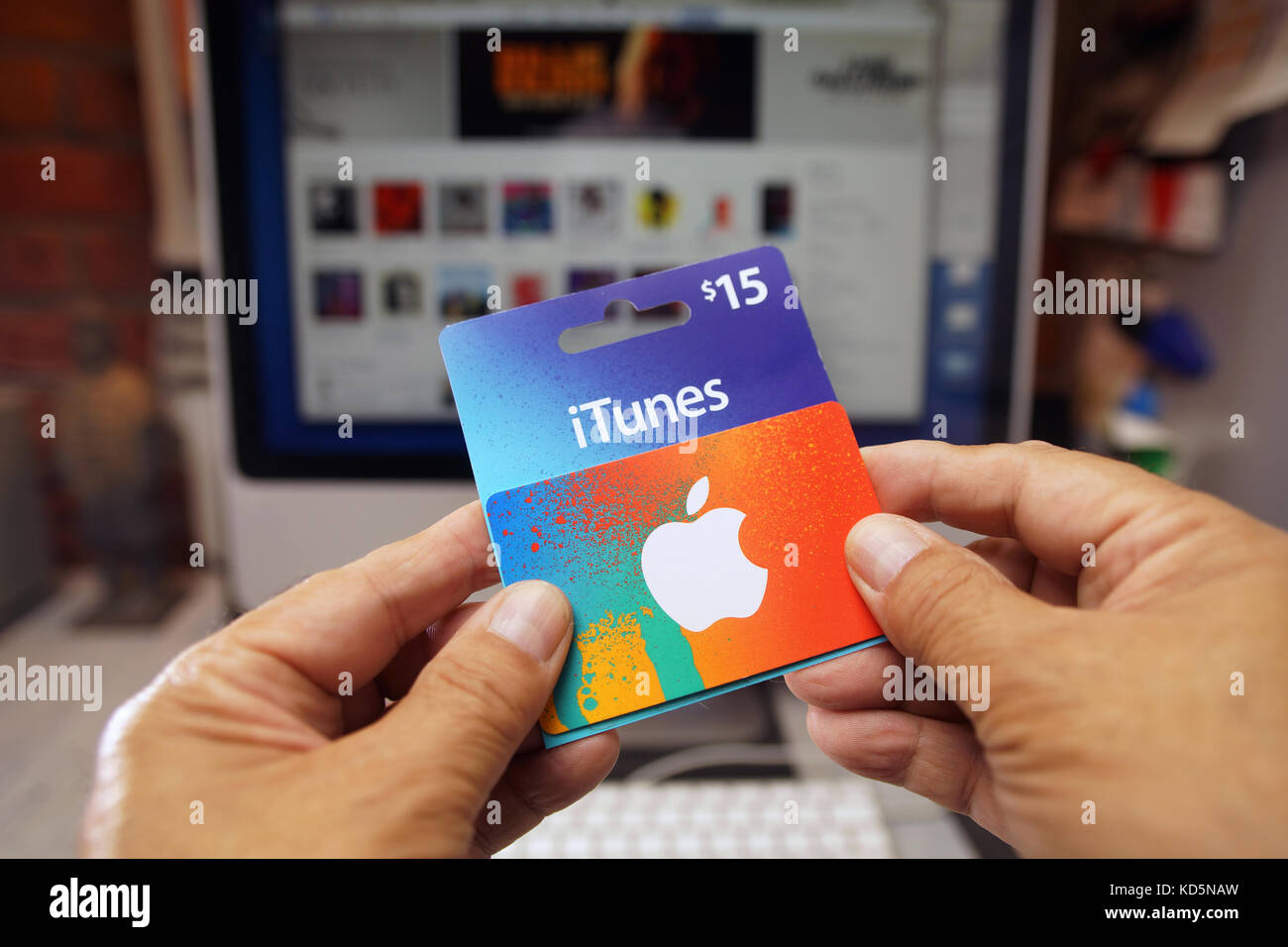 Hands holding a itunes gift card stock photo royalty free image hands holding a itunes gift card negle Images