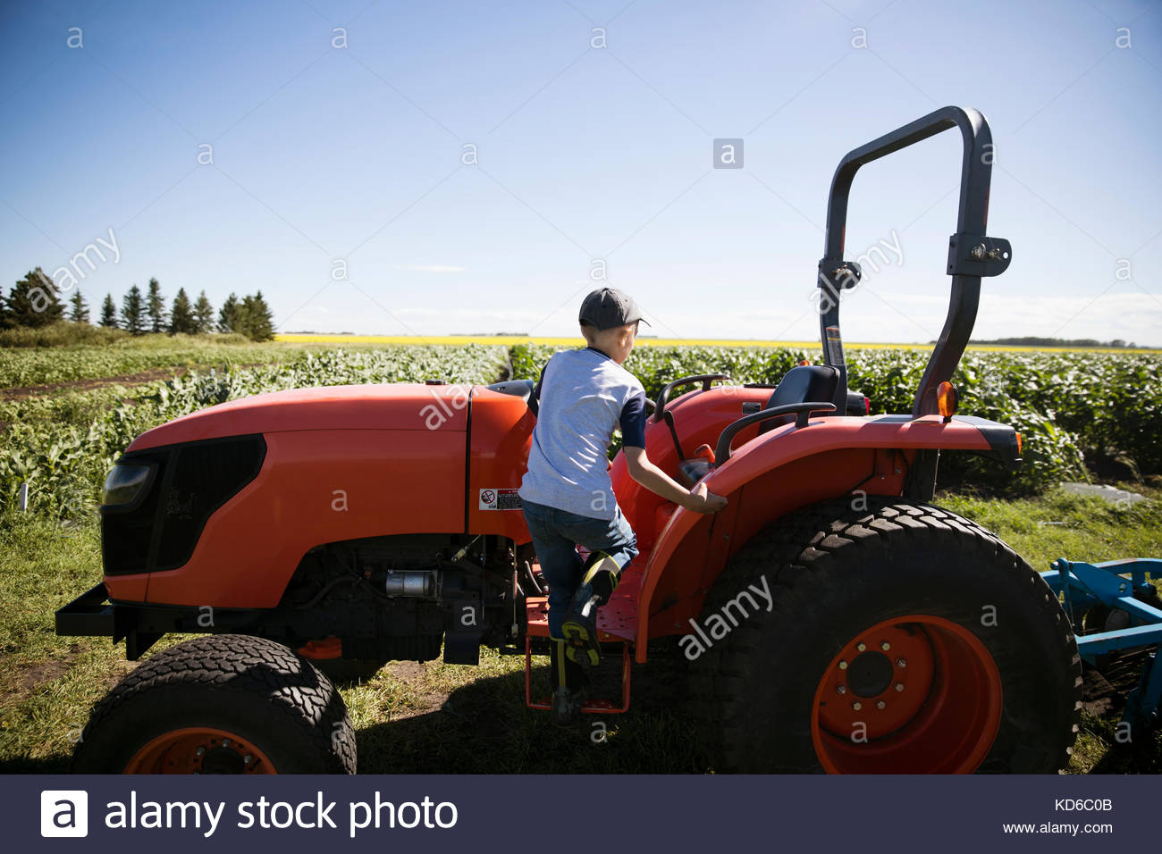 Boy On Tractor : Tractor boys stock photos images alamy