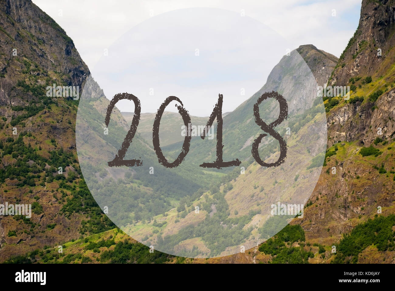 text 2018 for happy new year greetings valley with mountains in norway peaceful landscape scenery with grass trees and rocks