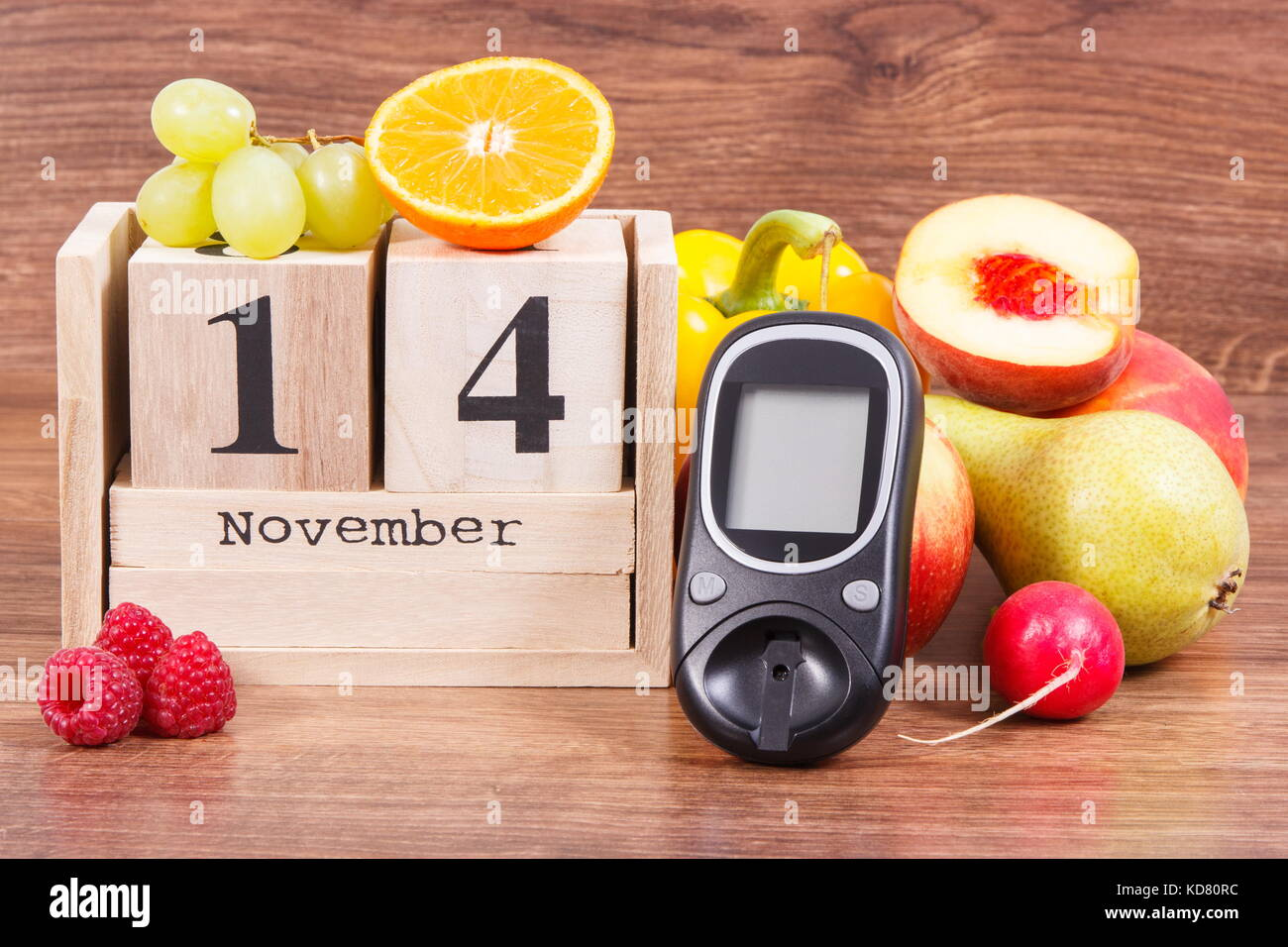 Date 14 november as symbol of world diabetes day glucose meter date 14 november as symbol of world diabetes day glucose meter for measuring sugar level and fruits with vegetables concept of fighting disease biocorpaavc
