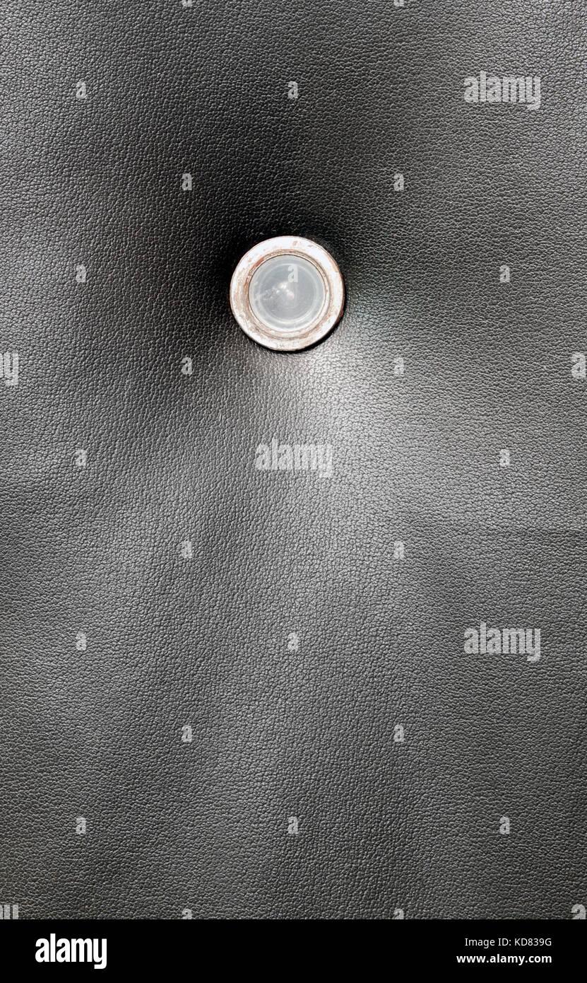 Dark grungy door leather with peeling door spy hole & Dark grungy door leather with peeling door spy hole Stock Photo ...