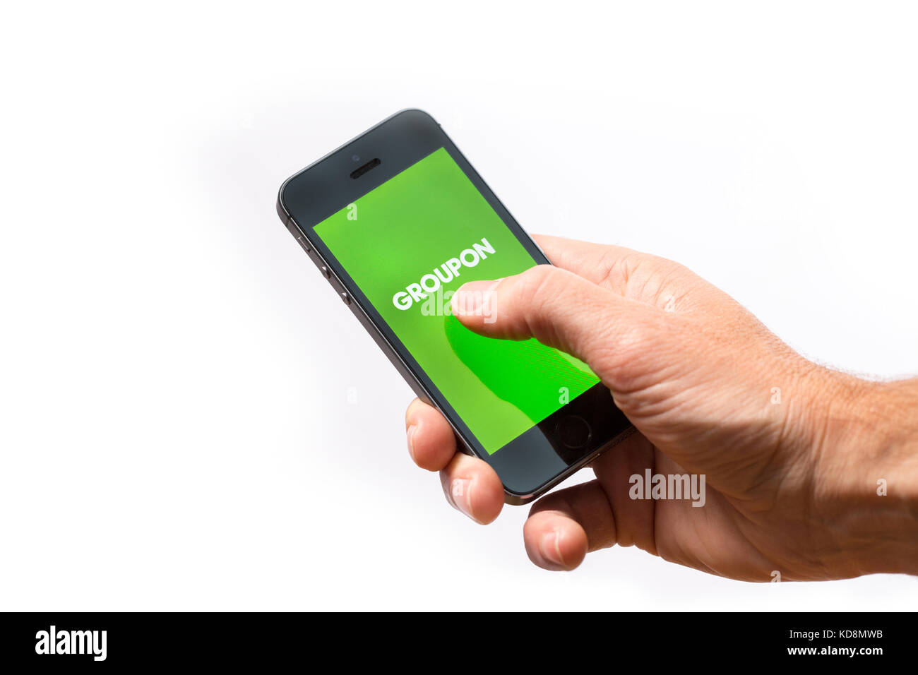 Groupon logo stock photos groupon logo stock images alamy a man using the groupon app on a mobile phone stock image buycottarizona Image collections
