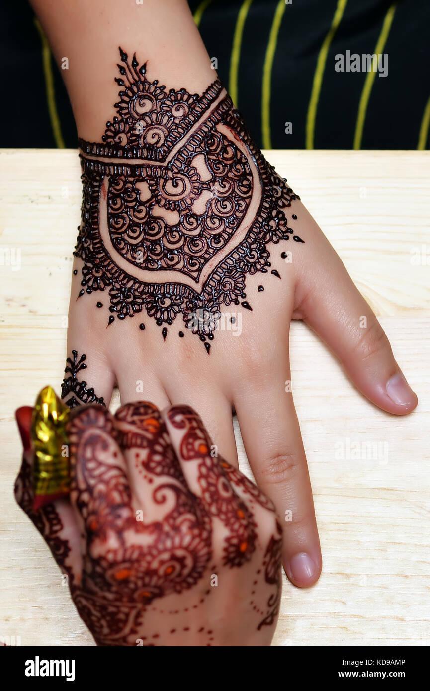 Artist Applying Henna Tattoo On Bride Hands On Wedding Ceremony Top