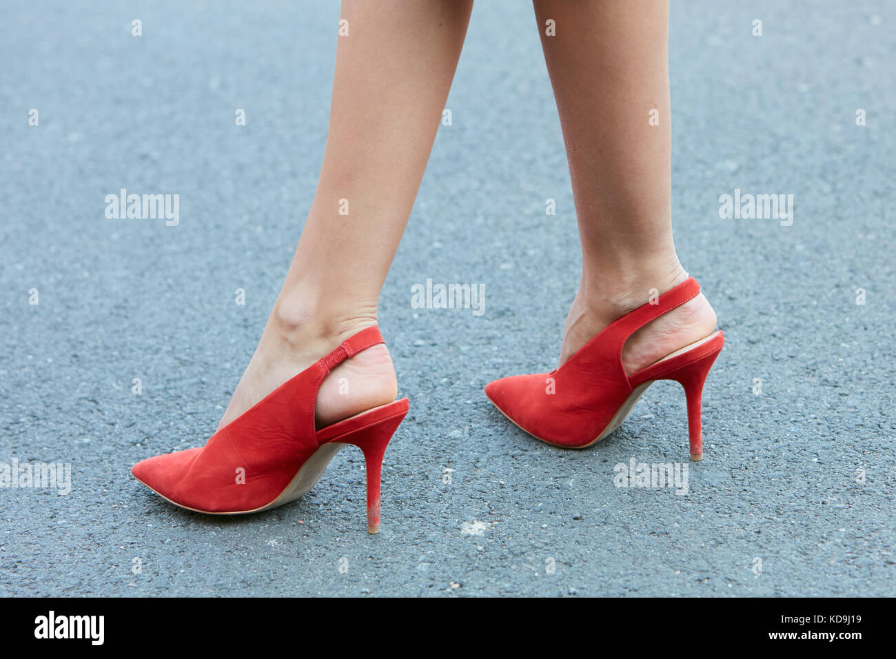 35fcda1dfd1 ... usa cheap sale MILAN - SEPTEMBER 21 Woman with red high heel shoes  before Fendi fashion ...