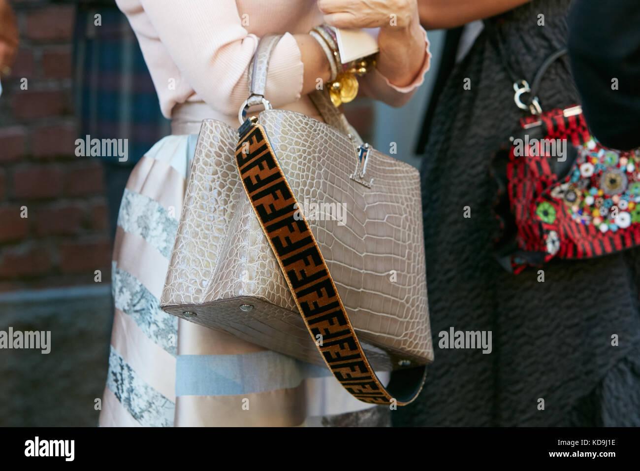 MILAN - SEPTEMBER 21  Woman with Louis Vuitton beige crocodile leather bag  and Fendi shoulder strap before Fendi fashion show 2b06baf669367