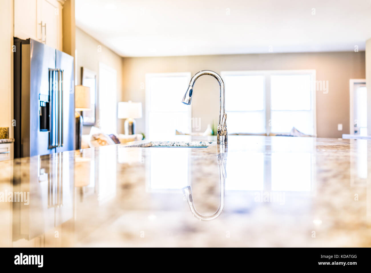 kitchen counter close up. New Modern Faucet And Kitchen Room Sink Closeup With Island Granite Countertops In Model House, Home, Apartment Counter Close Up