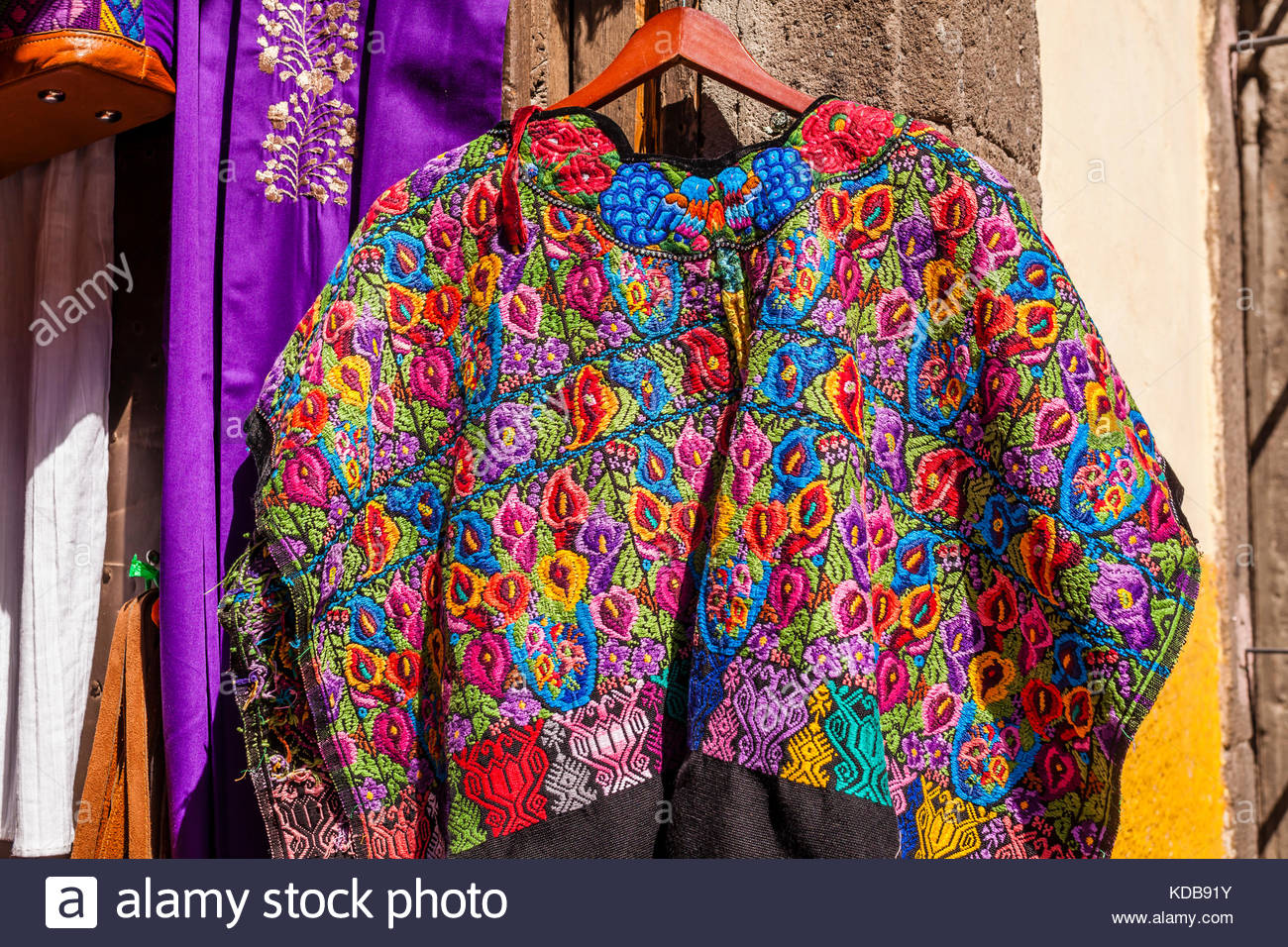 Colorful Fabric Poncho For Sale In Clothing Store Stock Photo