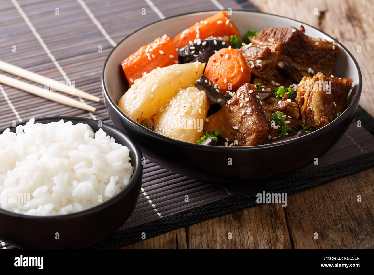Kalbi jjim is slowly braised beef short ribs in a soy sauce, sesame oil, and garlic sauce. It is often prepared for special occasions Kalbi jjim is slowly braised beef short ribs in a soy sauce, sesame oil, and garlic sauce. It is often prepared for special occasions new pictures
