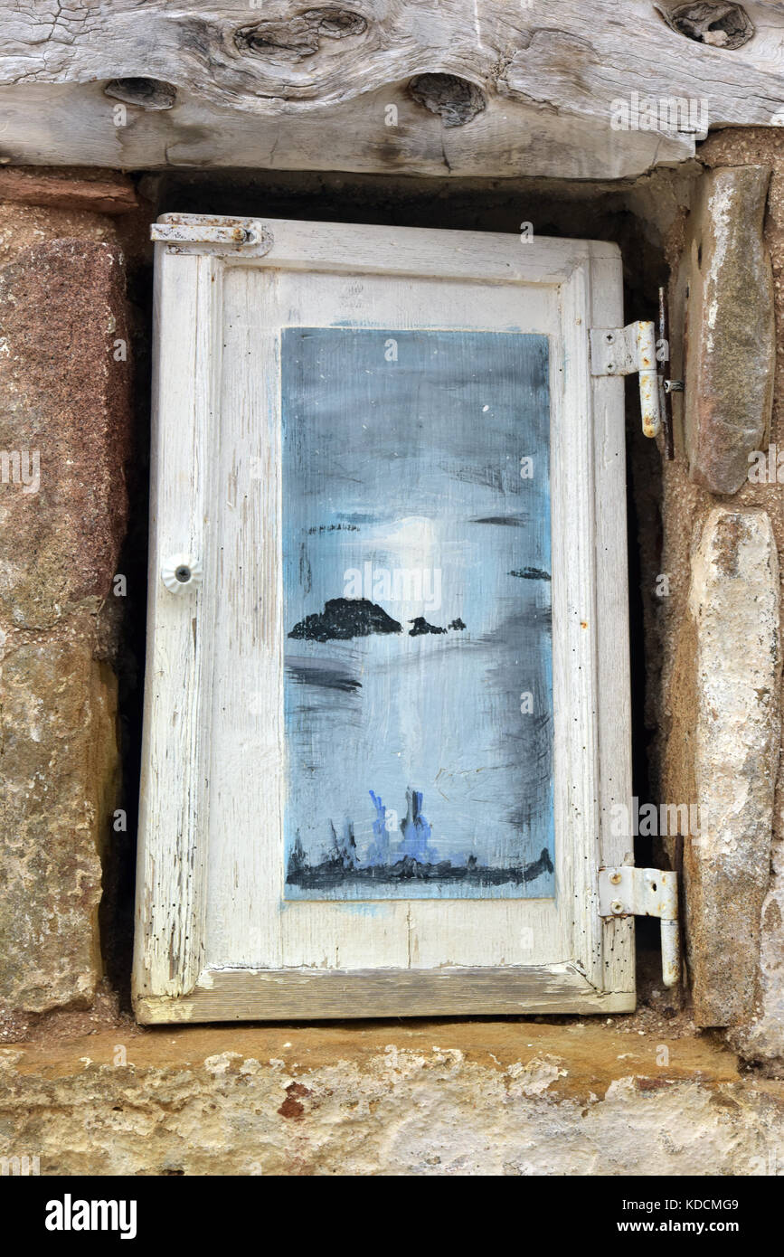 stock photo a distressed window frame with peeling paintwork in the shabby chic style of decoration on a greek country cottage - Distressed Window Frame