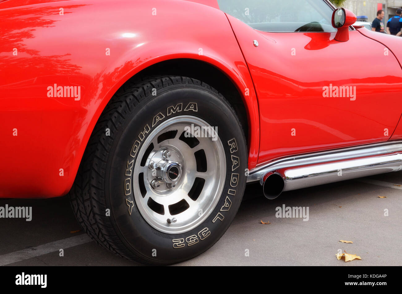 meeting of classic american cars rear wheel of red chevrolet corvette c3 stingray made