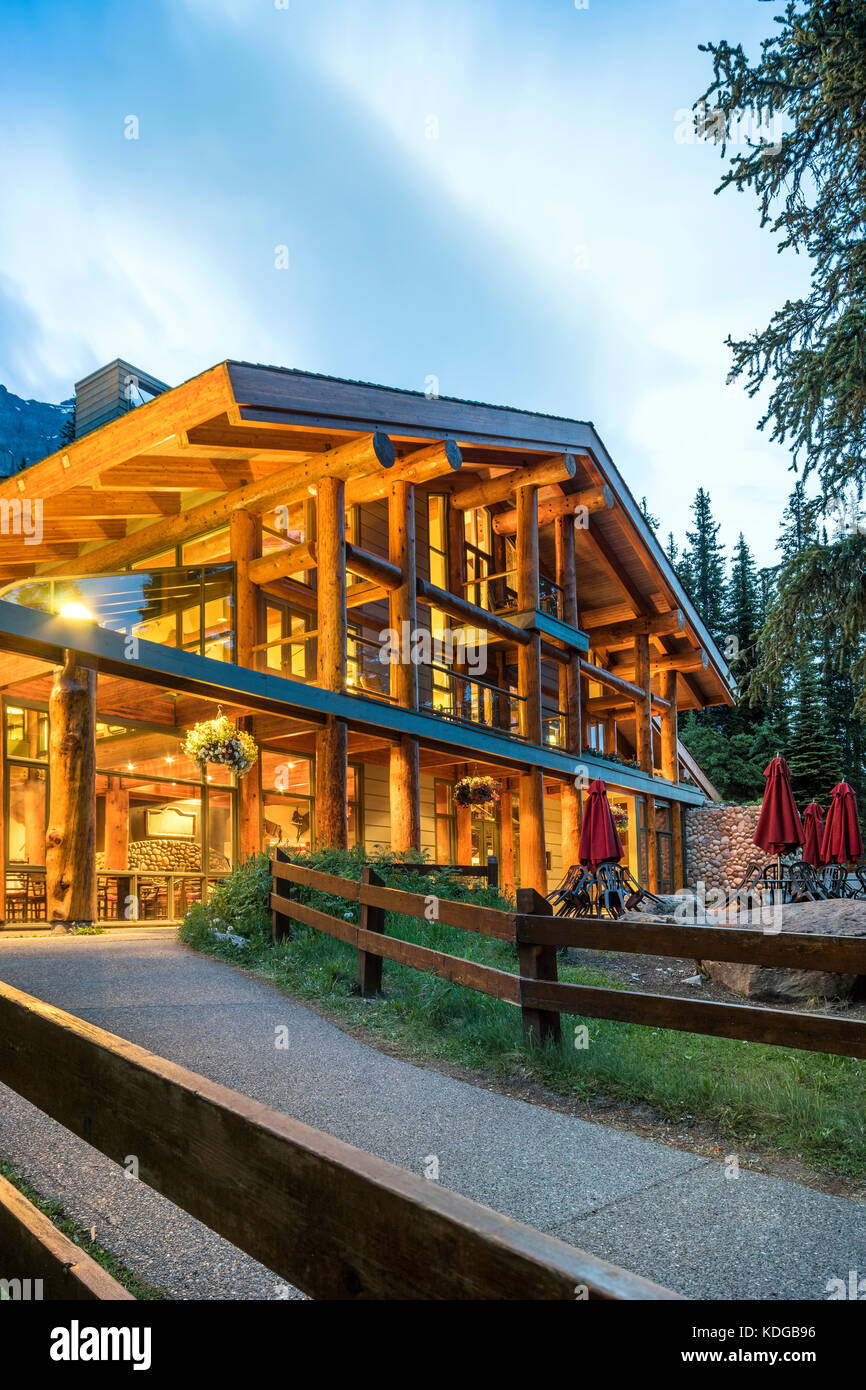 Illuminated luxurious log house in the mountains Stock Photo