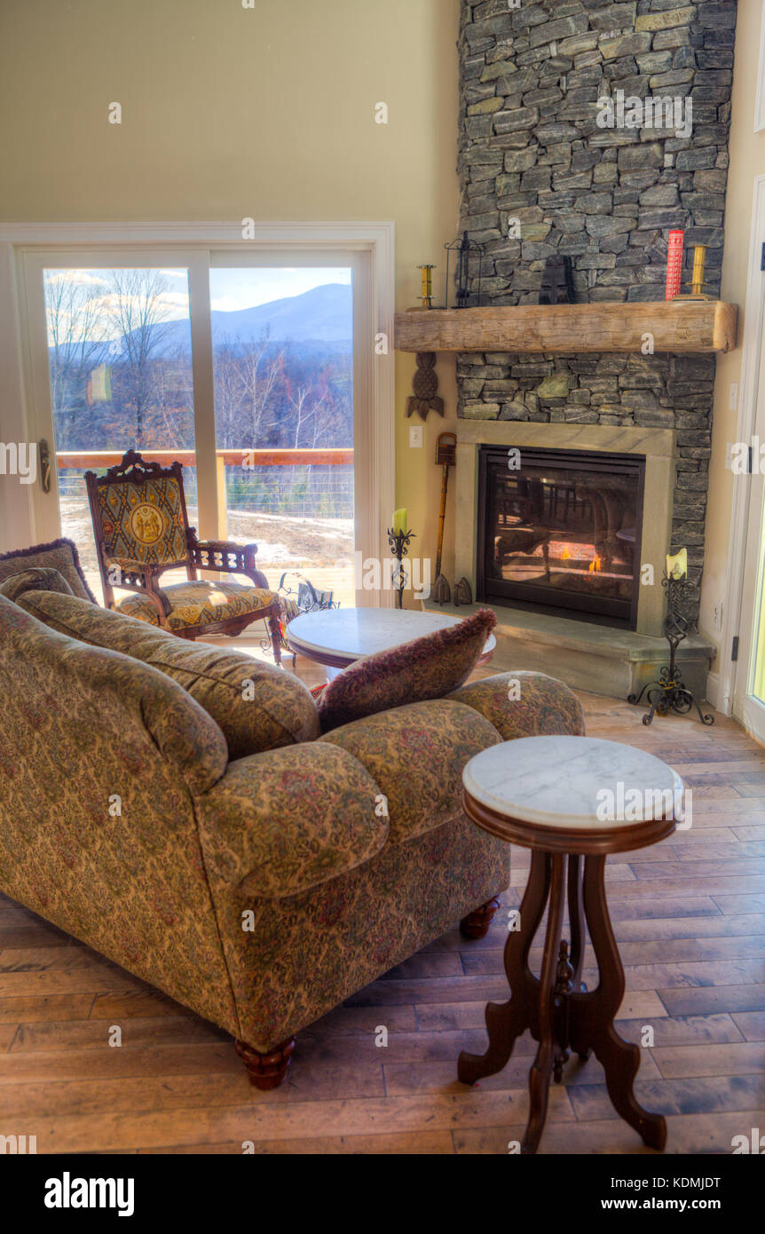 Modern Upscale Living Room With Adjoining Kitchen Dining And Stone Fireplace In Vermont USA