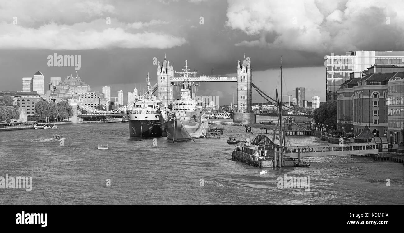 London - The panorama of the Tower bridge, riverside in evening light with  the dramatic