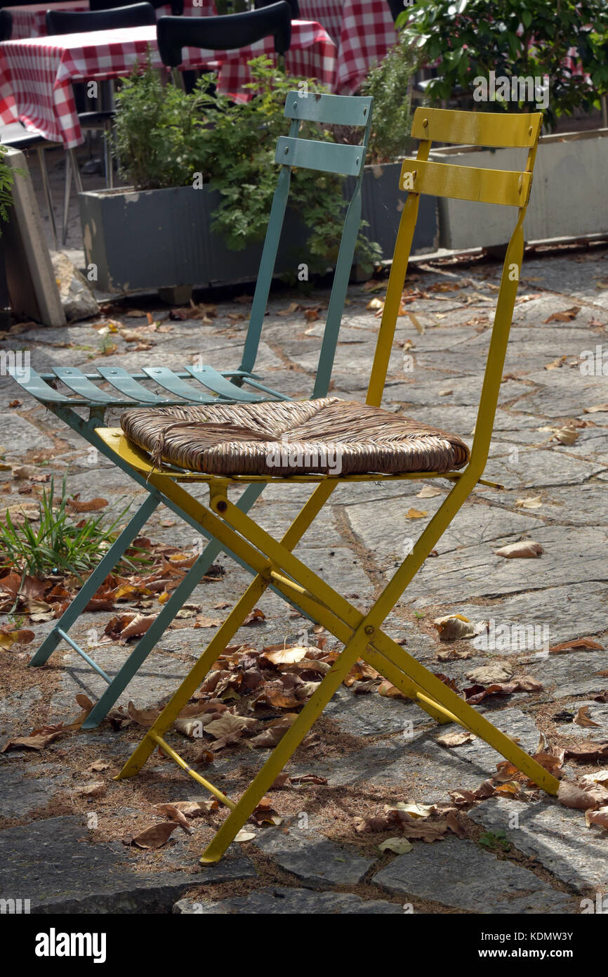 two folding metal chaise one blue and one yellow for use in the garden or patio furniture shabby chic style and distressed painted furnishings