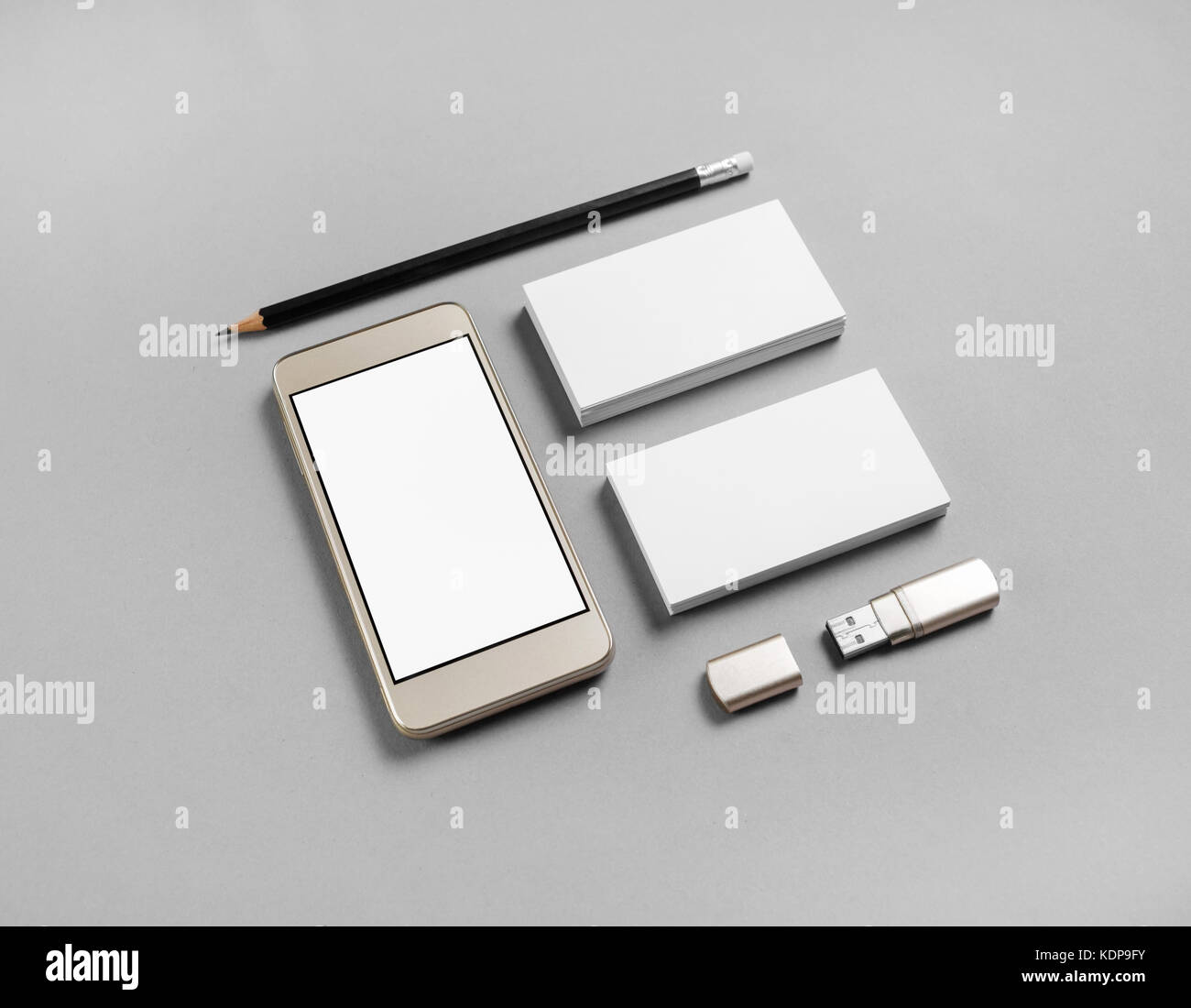 Cellphone and stationery on gray paper background. Blank business ...